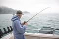 Senior Fisherman in Alaska Catches Silver Salmon
