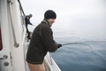 Two Young Fisherman in Alaska Fish for Silver Salmon