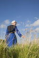 Old Order Amish Woman Walking in a Field