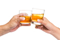 Two hands toasting whiskey on the rock, in white background