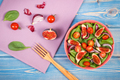Fresh prepared fruit and vegetable salad and ingredients for preparing meal