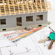 Small house under construction, keys and currencies euro on electrical drawings for project - PhotoDune Item for Sale