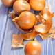 Peeled fresh onions lying on purple boards, healthy nutrition concept - PhotoDune Item for Sale