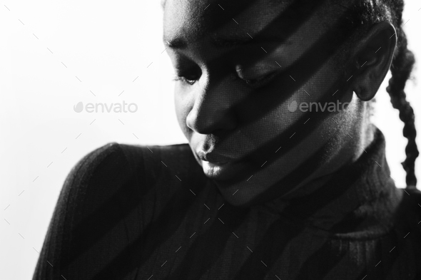 Creative stripes from projection light on beautiful woman with dark skin - Stock Photo - Images