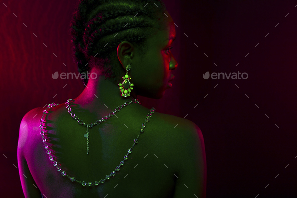 Colorful and creative portrait of african womans back with dark skin - Stock Photo - Images