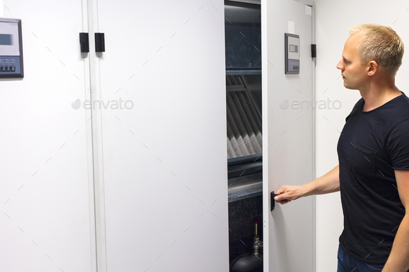 Technician Opening Air Conditioner Cabinet In Datacenter - Stock Photo - Images