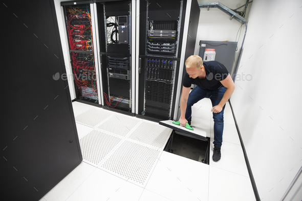 Computer Engineer Lifting Floor Tile Using Suction Cups In Datac - Stock Photo - Images