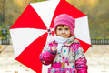Portrait of a little girl with an umbrella