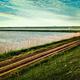Rural road passing through rice fields - PhotoDune Item for Sale