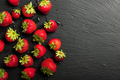 Fresh strawberries on black background - PhotoDune Item for Sale
