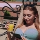 Bikini Girl with Phone Drinking Juice - VideoHive Item for Sale