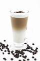Latte macchiato with coffee beans