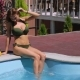 Bikini Girl Relaxing at the Edge of Swimming Pool - VideoHive Item for Sale