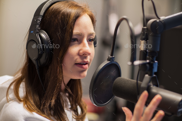 Female Jockey Talking On Microphone In Radio Studio - Stock Photo - Images