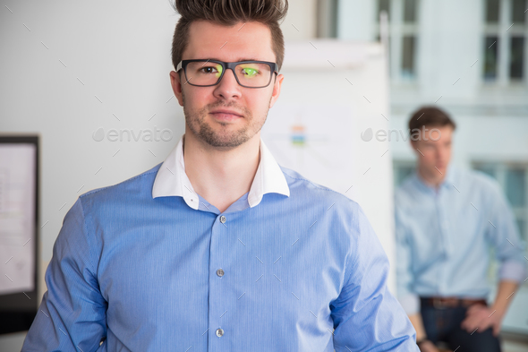 Confident Businessman Wearing Eyeglasses In Office - Stock Photo - Images