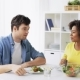 Happy Couple Eating Vegetable Salad at Home 22