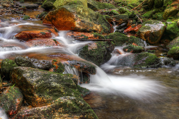 Water flowing over rocks - Stock Photo - Images