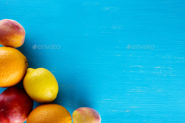 Fresh raw fruits on a blue wooden background - Stock Photo - Images