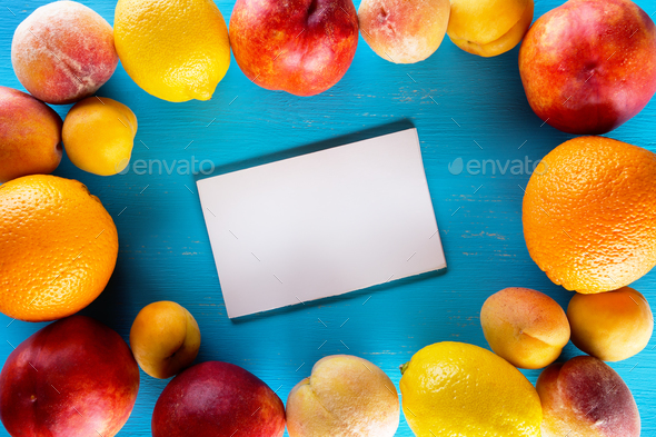 Fresh fruits on a blue wooden table - Stock Photo - Images