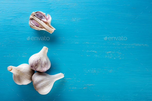 Raw garlic on a wooden table - Stock Photo - Images