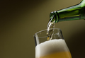Pouring beer into a glass - PhotoDune Item for Sale