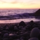 Smooth Pebble Stones on a Sea Shore at Dramatic Sunset. Shallow Depth of Field - VideoHive Item for Sale