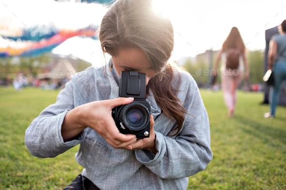 Woman making photo on retro camera - Stock Photo - Images