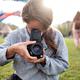 Woman making photo on retro camera - PhotoDune Item for Sale
