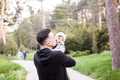 Father with his son in hands in walk at the park - PhotoDune Item for Sale