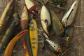 Antique Fishing Lures in a Messy Pile
