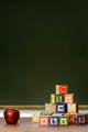 Apple and wooden blocks in front of blackboard - PhotoDune Item for Sale