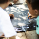 Group of Diverse Kids Drawing on Chalkboard Together - PhotoDune Item for Sale