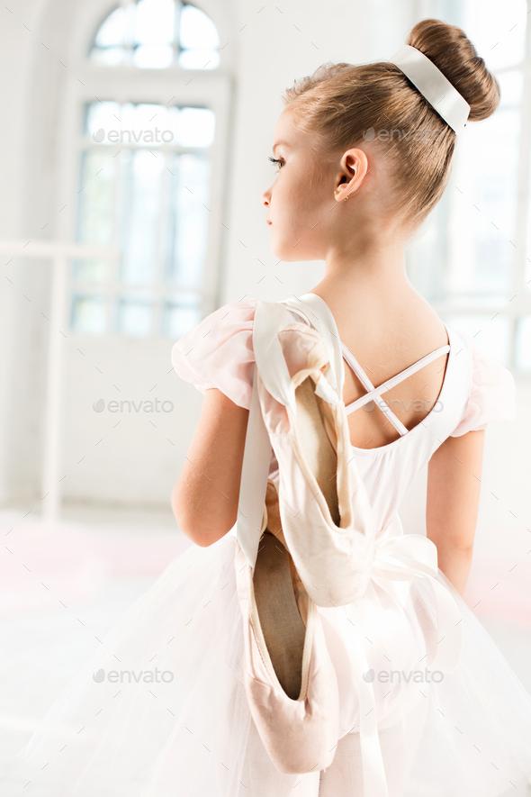 7c75005c0eba Little ballerina girl in a tutu. Adorable child dancing classical ...
