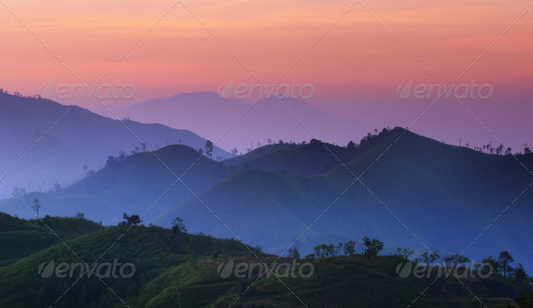 Landscape of sunrise over mountains in Kanchanaburi,Thailand  - Stock Photo - Images