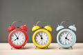 Three colorful alarm clocks on desktop - PhotoDune Item for Sale