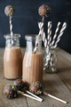 Bottles of chocolate milk with straws and cake pops - PhotoDune Item for Sale