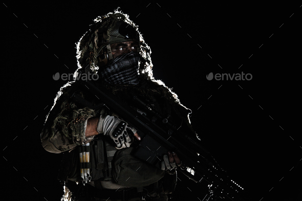 Army sniper with painted face - Stock Photo - Images