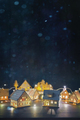 Wooden houses with lights on table for the holidays - PhotoDune Item for Sale