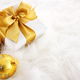 Gold ribboned gifts with Christmas ornaments - PhotoDune Item for Sale