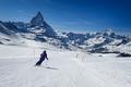 Female skier skiing towards Matterhorn mountain - PhotoDune Item for Sale