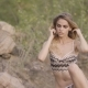 The Girl in the Lingerie Is Posing on Camera - VideoHive Item for Sale