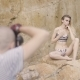 The Girl Posing for Photographer in the Underwear. Photograph Session in Nature. - VideoHive Item for Sale