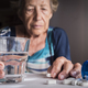 Oldster taking daily medication dose at home, Andalusia, Spain - PhotoDune Item for Sale