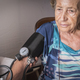 Doctor measures the arterial tension to oldster at home, - PhotoDune Item for Sale