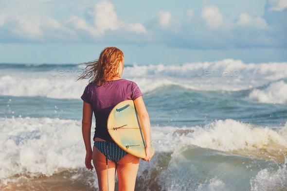 Surfer girl enjoying vacations - Stock Photo - Images