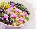 Tasty and healthy oatmeal porridge with fruit, berry and flax seeds.