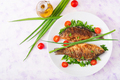 Fried fish carp and fresh vegetable salad. Flat lay. Top view