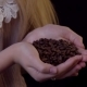 Smelling Coffee Beans - a Young Woman Cups Them in Her Hands - VideoHive Item for Sale