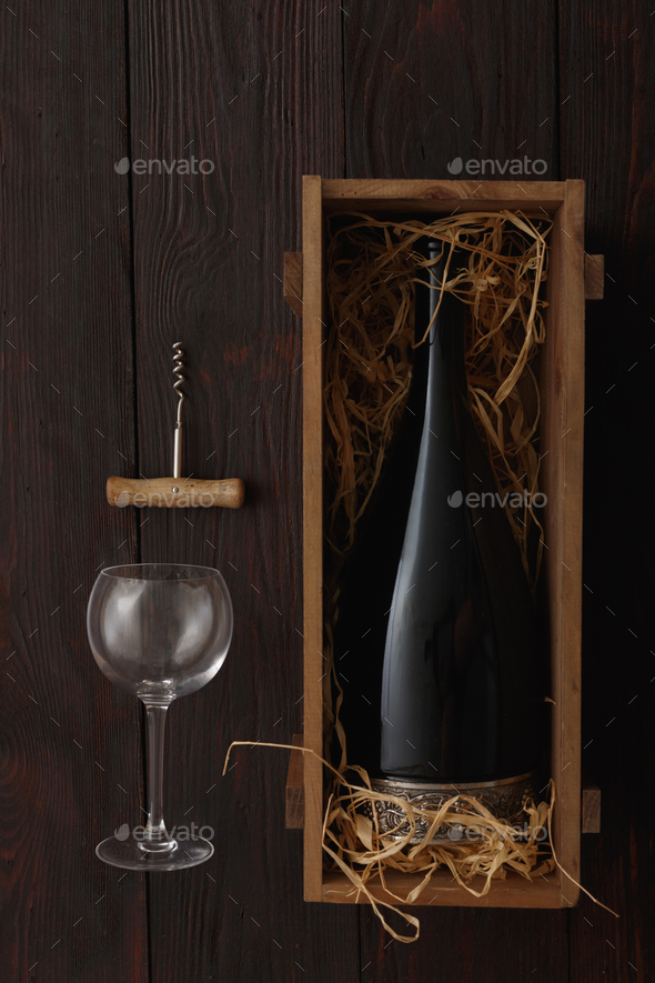 Red wine bottle, glasses, corkscrew, flat lay - Stock Photo - Images