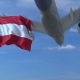 Commercial Airplane Landing Behind Waving Austrian Flag